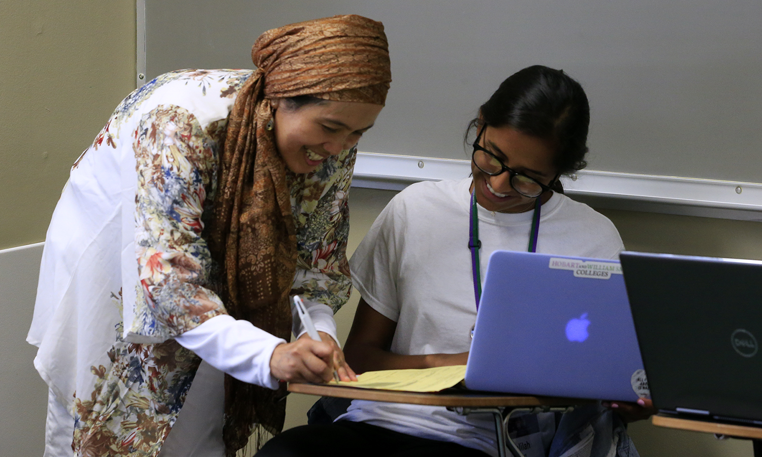 Professor of Religious Studies Etin Anwar assists ______ '22 in making class selections.