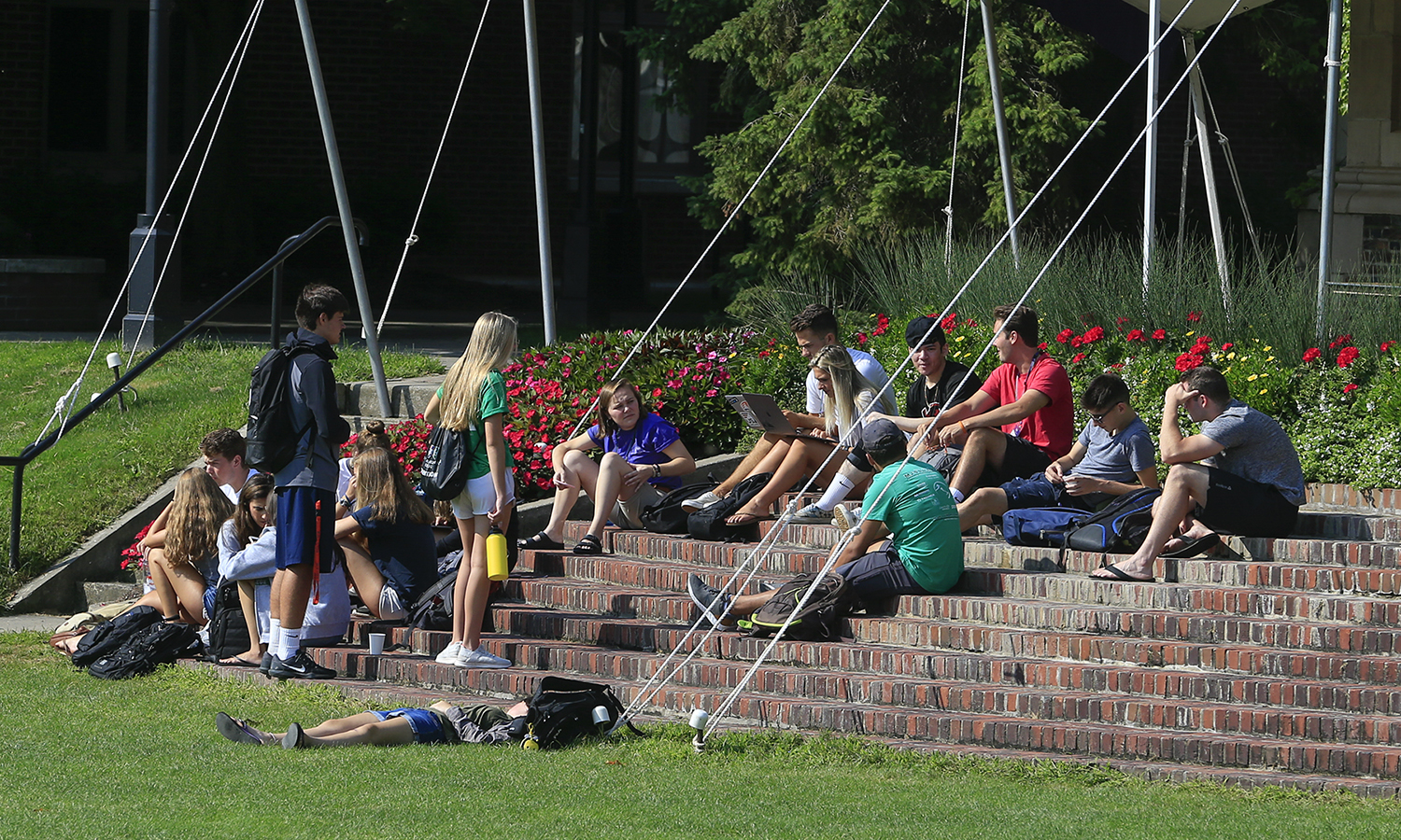 Students relax on the steps of Coxe Hall on Monday.