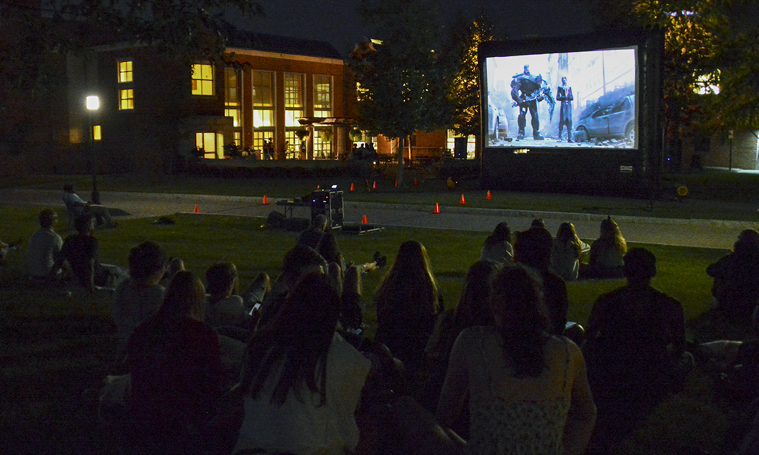 Students watch a movie across on the Bristol green during Orientation Weekend.