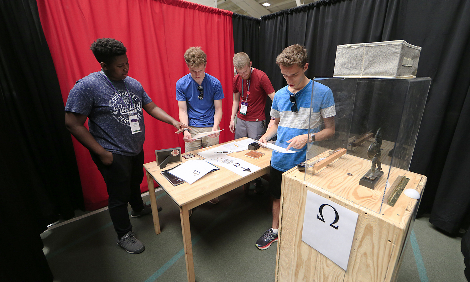 Sammy Adcock '22, Kayon'Dre Betaudier '22, Nicholas Barbaccia '22 and Matthew Ayres '22 collaborate to break out of an escape room during Orientation Weekend's teambuilding session at Bristol Field House.