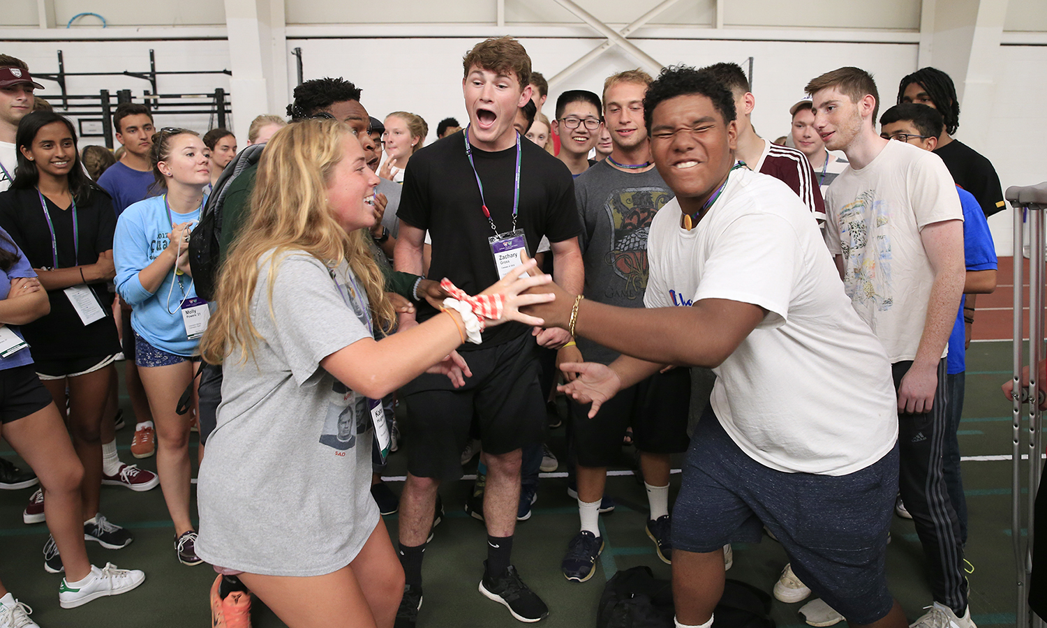 "Rock-paper-scissors champions Kate Hughes '22 and Najem ""Naj"" Johnson '22 battle for victory during Orientation weekend's teambuilding session in Bristol Feild House."
