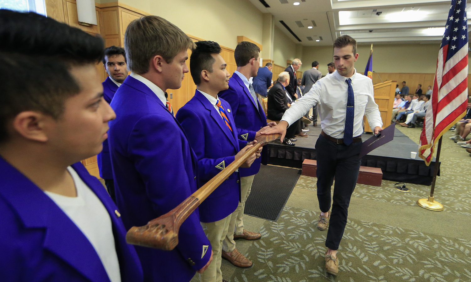 Nathan Jacon '22 (??) touches the Paddle of the legendary Seneca warrior Agayentah held by members of the Druid Society during Hobart College Matriculation.
