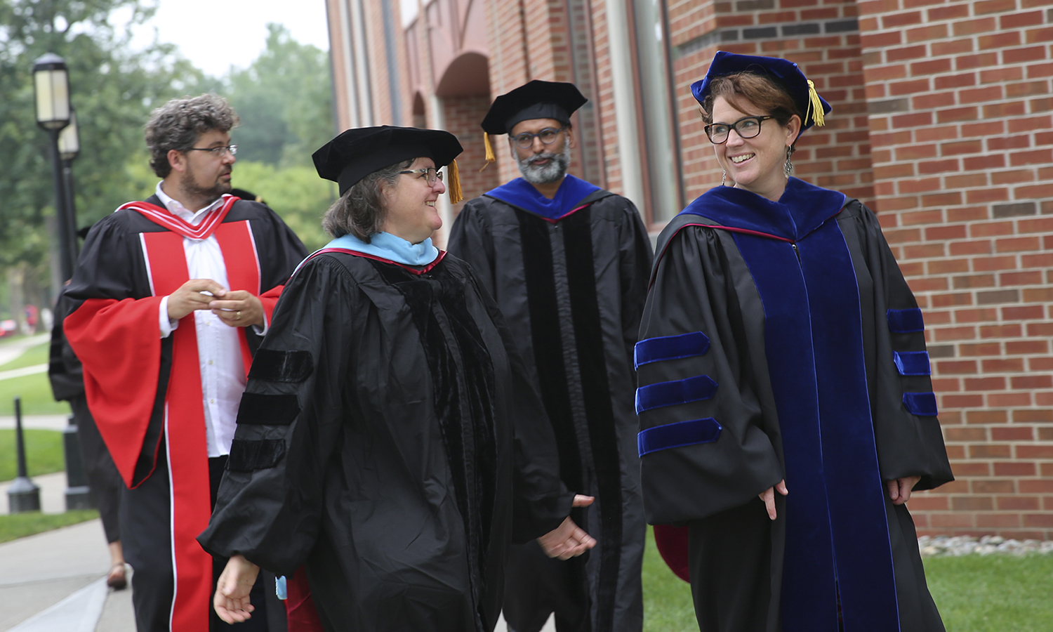 Associate Professor of Education Mary Kelly (front left), Associate Professor of Political Science Stacey Philbrick Yadav, Associate Professor of English Rob Carson (back left) and Associate Professor of Political Science Vikash Yadav process before Convocation 2018.