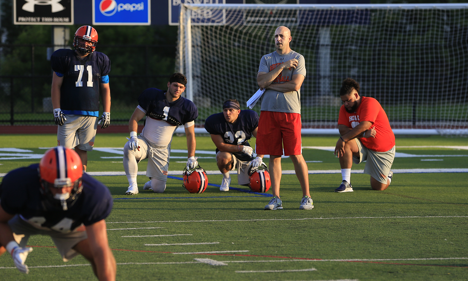 Hobart College Head Football Coach Kevin DeWall '00 leads a preseason practice.