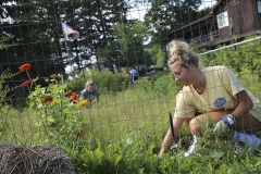 Brynn Bushey '22 gardens at Fribolin Farm as part of the 2018 Day of Service during Orientation weekend.