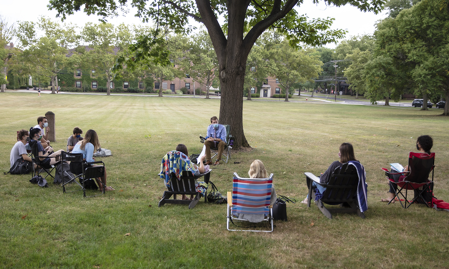 "Associate Professor of Writing and Rhetoric Ben Ristow holds ""Power and Persuasion"" outside. Power and Persuasion focuses on research methods in rhetorical criticism and builds from a central foundation in rhetorical history, theory, and practice."