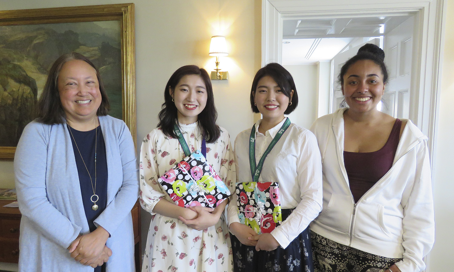 President Joyce P. Jacobsen and Dominique Marshall 'xx (right) welcome Technos International Students Yui Omata and Miho Kawamura to campus. Their visit was coordinated by Tanaka Lecturer in Japanese Kyoko Klaus.