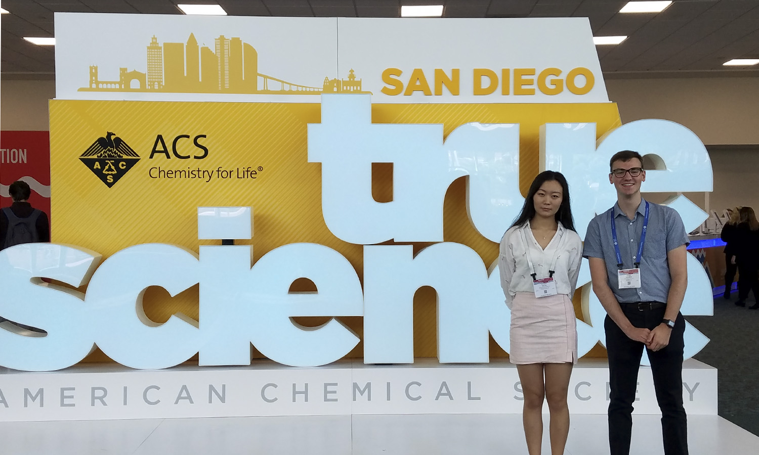 "Students in Assistant Professor of Chemistry Elana Stennett's research group, Noah Kilmer 'xx and Yating ""Sherry"" Zhang 'xx, pose at the Fall 2019 National American Chemical Society Meeting and Expo. Students presented their research at the Environmental Chemistry Division Poster Session."
