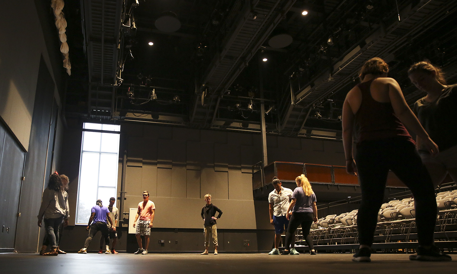 Members of the HWS social justice theatre group Mosaic NY and Associate Professor of Theatre Heather May prepare for the upcoming semester in the McDonald Theatre.