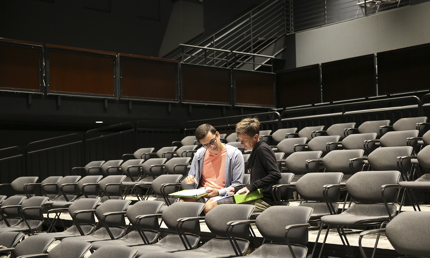 Luis Figueroa '18 and Associate Professor of Theatre Heather May discuss upcoming programming after rehearsal. As part of ongoing support of local youth, the HWS theatre troupe Mosaic NY will offer social justice theatre programing to members of the Justice Organization for Youth (JOY) with the establishment of the Mosaic NY Fellowship this year. Figueroa will serve as the inaugural Mosaic NY Fellow.
