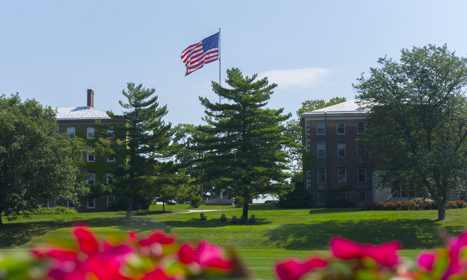 The American flag flies over the Quad.