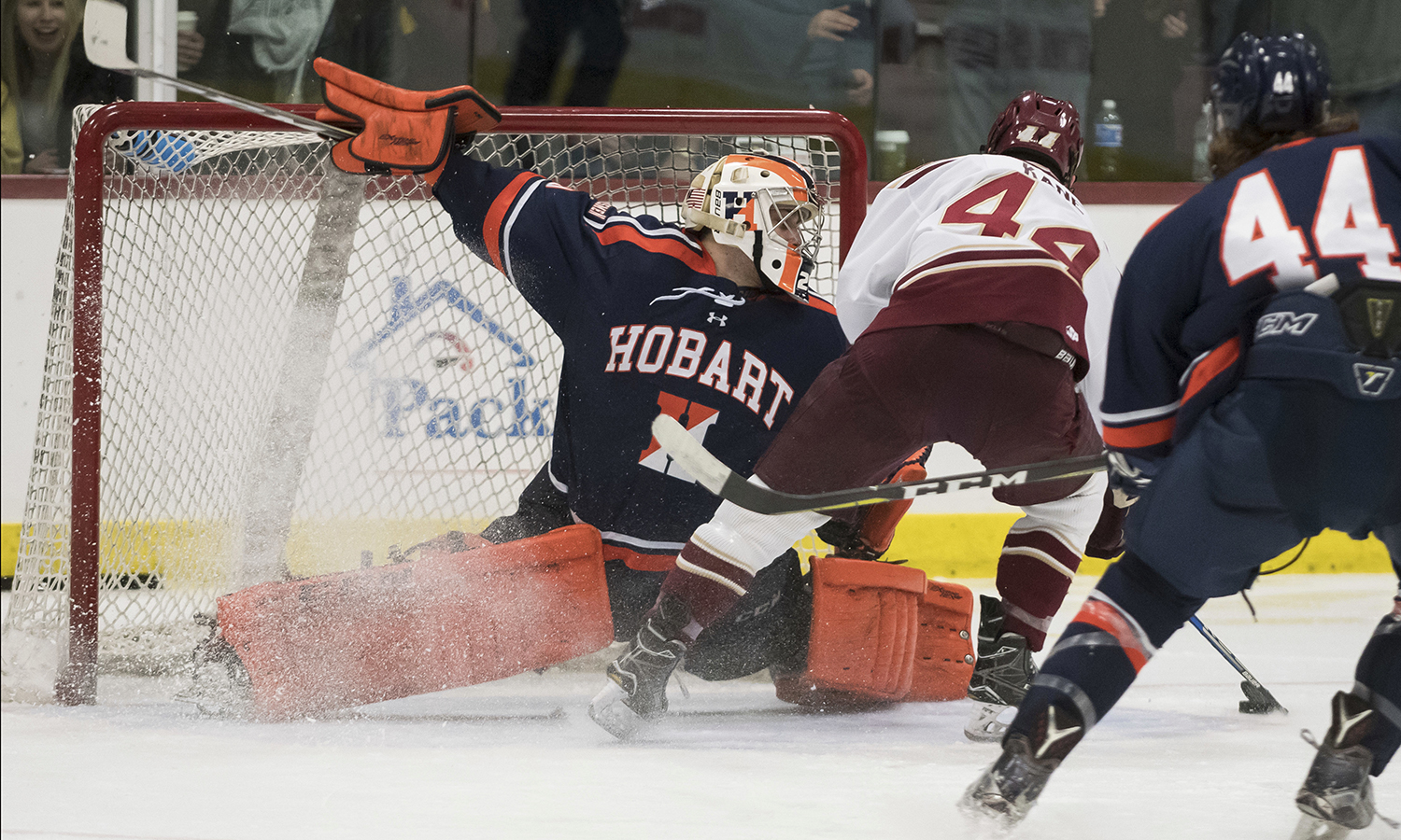 Frank Oplinger '18 makes a save during Hobart's 3-0 win over Norwich University during the 2018 New England Hockey Conference Tournament in Northfield, Vt.