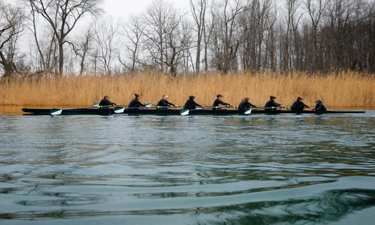 The William Smith rowing team practices on the Cayuga-Seneca Canal. The Herons finished third in the Liberty League Championships, winning a silver medal in the varsity eight and a bronze medal in the second varsity eight and varsity four.