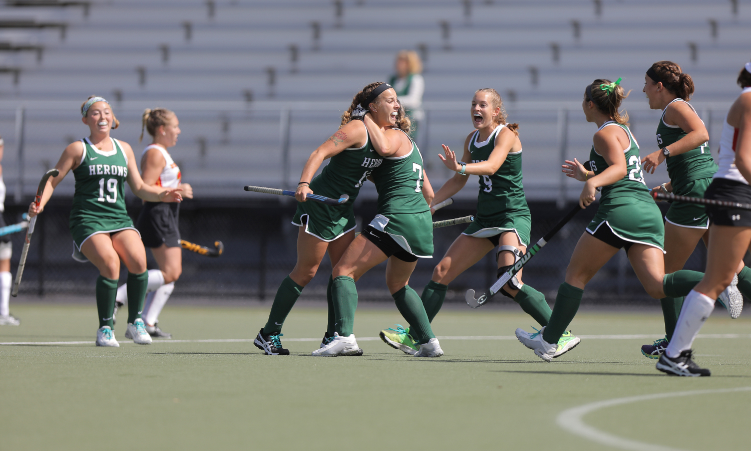 Hannah Wood '18 celebrates after a goal during the Heron's 4-3 win over Ursinus College.