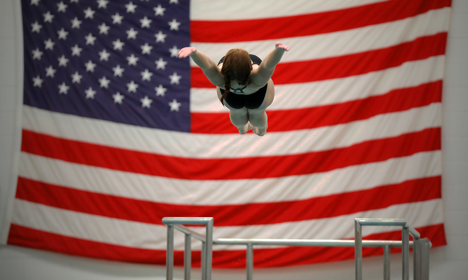 Therese Mandracchia '19 performs a back dive off the 3-meter board during a meet in Bristol Pool.