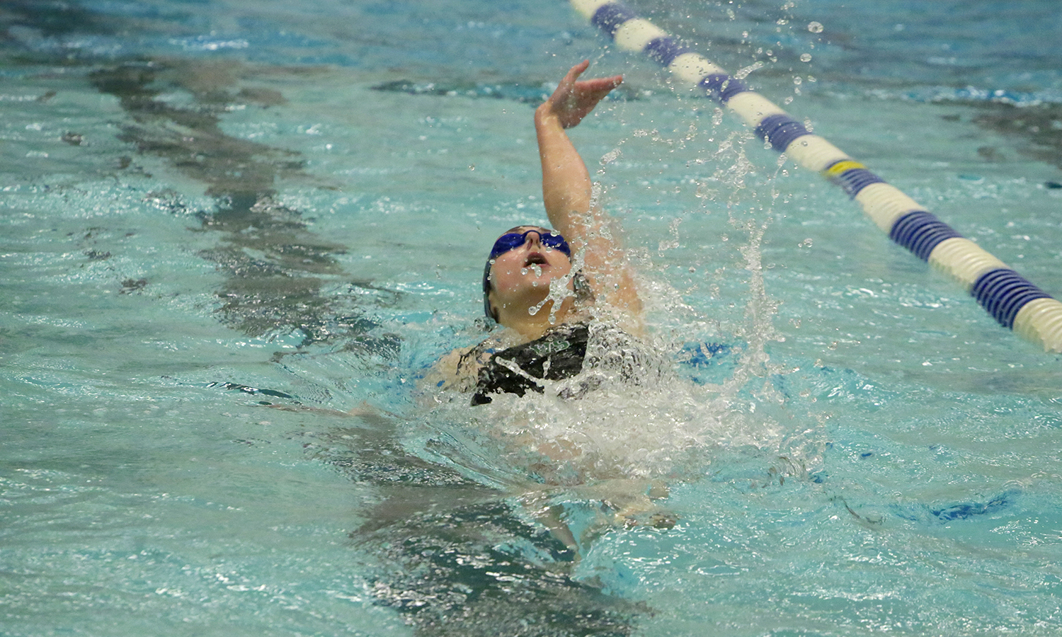 Anna Leffler '20 swims the backstroke as part of the 200 individual medley during William Smith's 143-95 win over Alfred University.