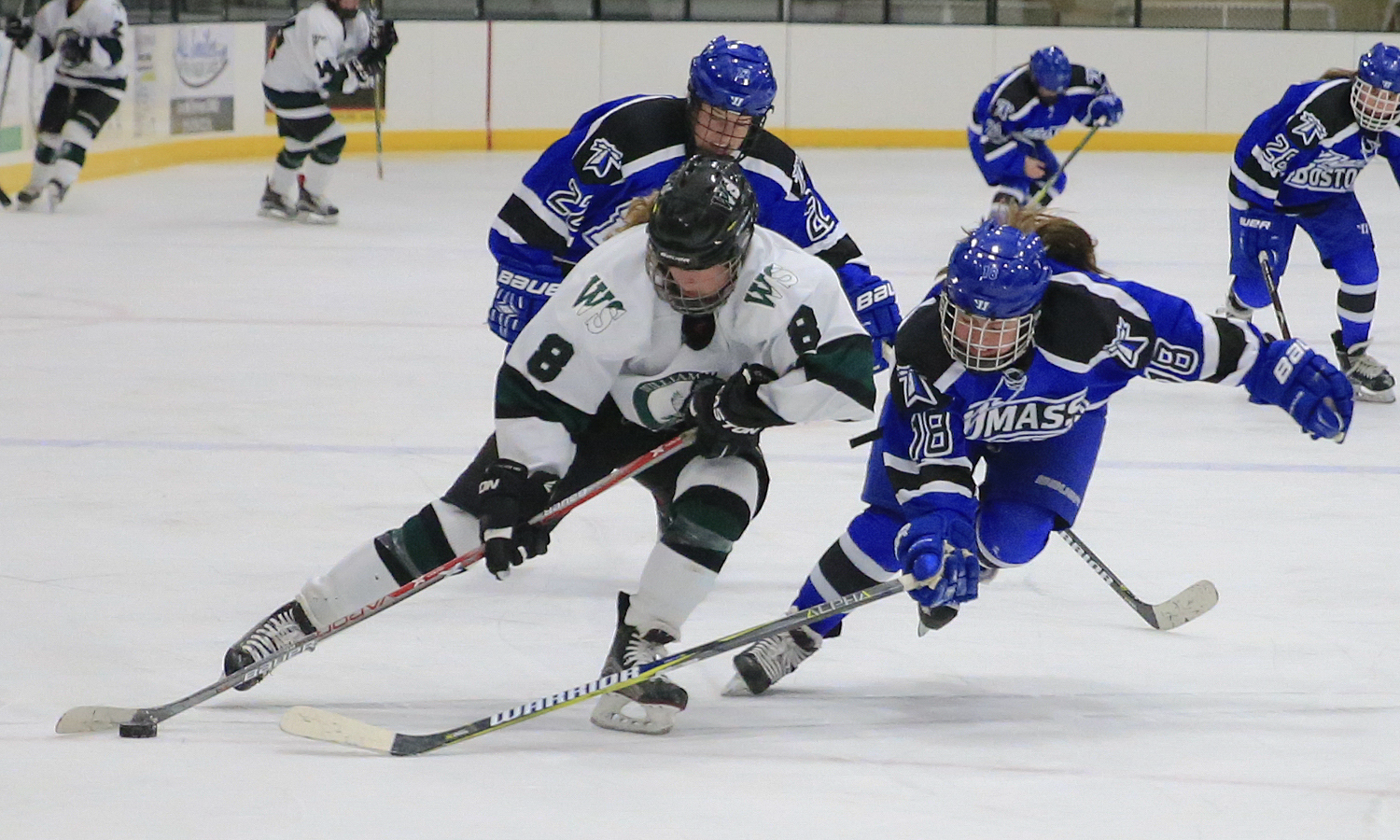 Lindsay Brown '19 protects the puck during William Smith's 2-2 tie against the University of Massachusetts at Boston.