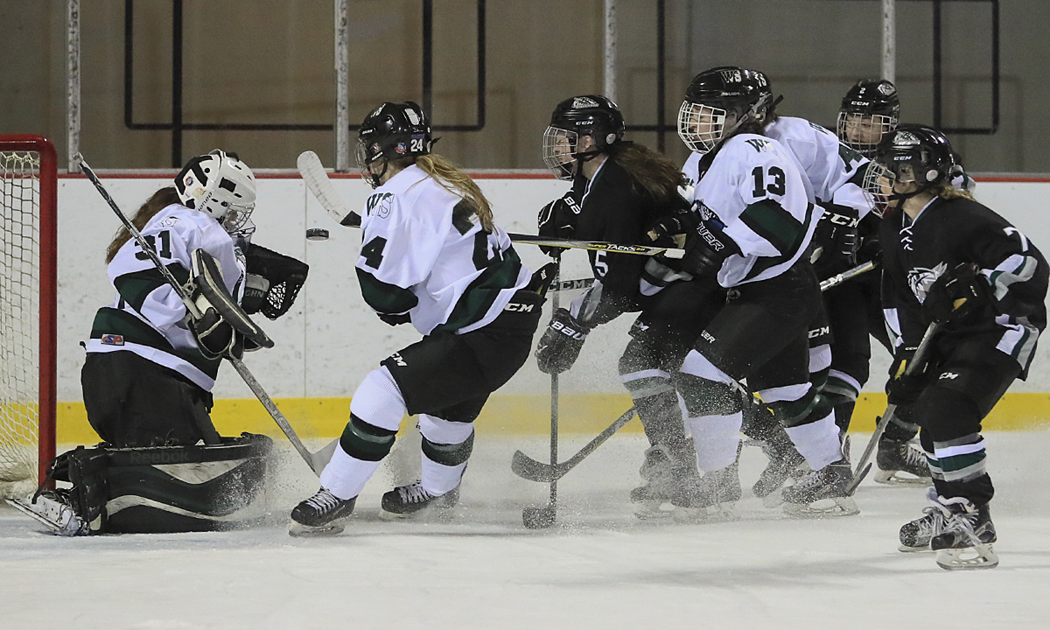 Maggie Salmon '18 stops a shot on goal during William Smith's game against Stevenson University in the first round of the United Collegiate Hockey Conference Tournament. It was the Herons' first postseason game in program history.