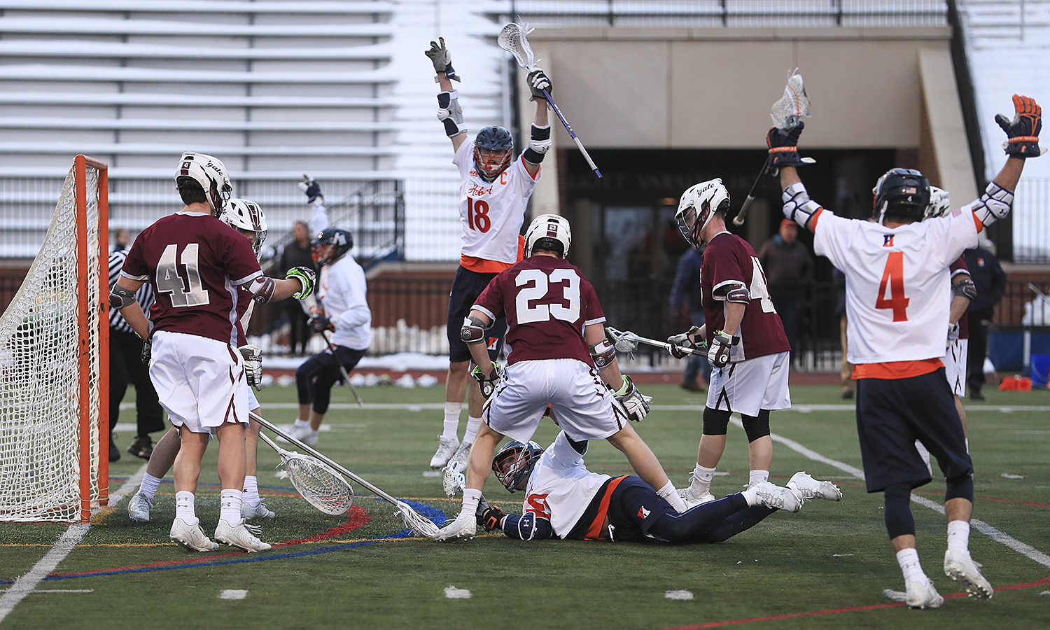 Members of the Hobart lacrosse team celebrate after a diving goal by Justin Scott '20. Scott scored a career-high six goals, tying the record for a Statesman in a Division I game.