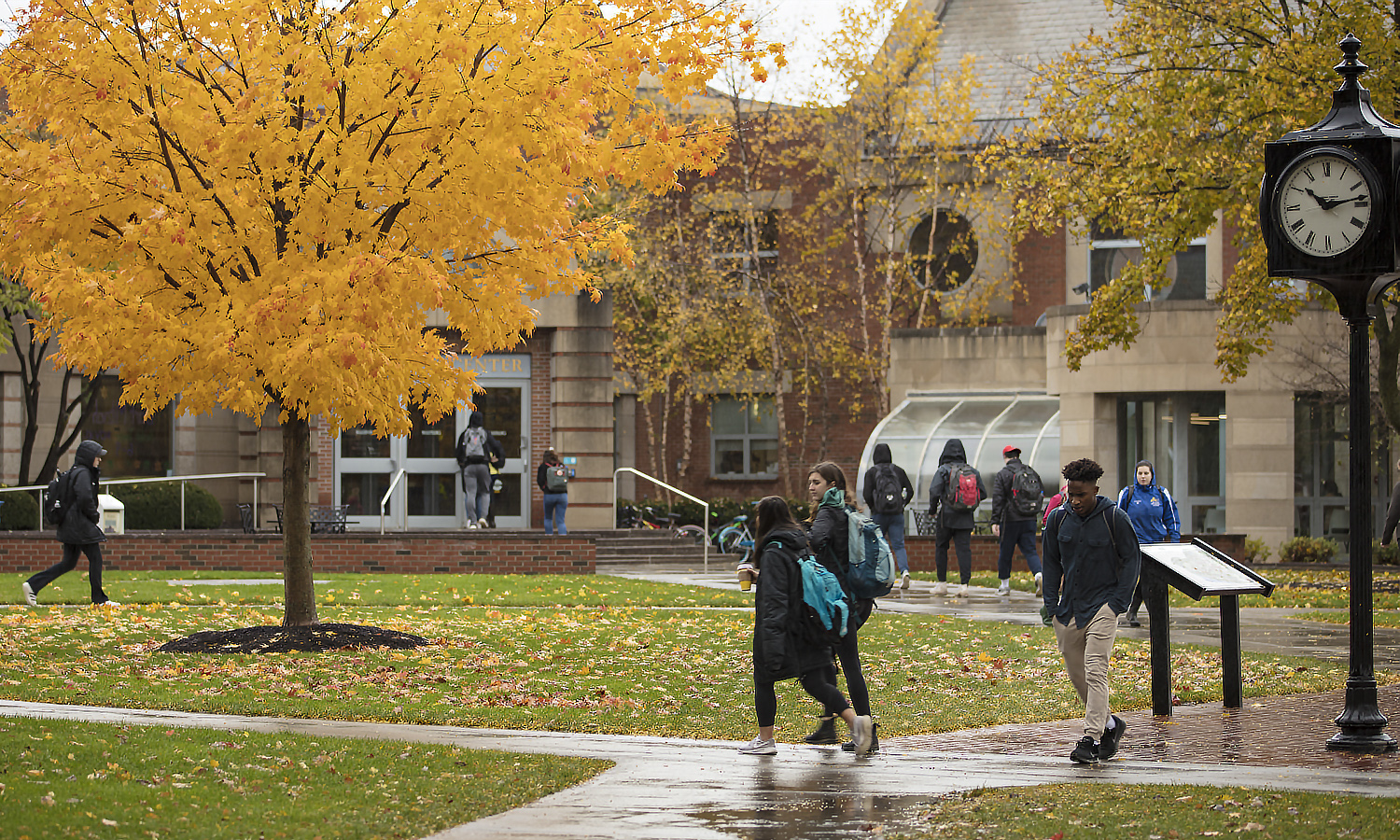 Students make their way to class on a rainy fall day.