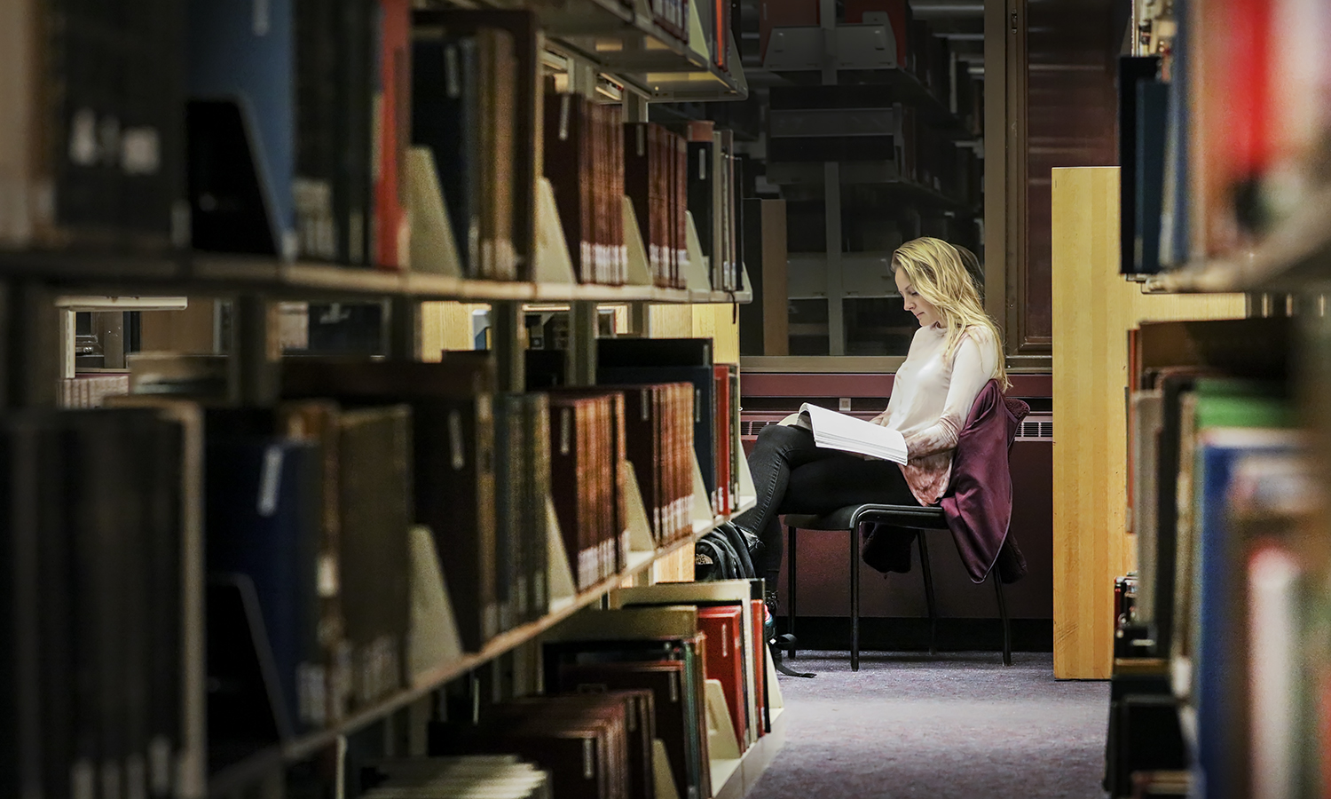 """In Warren Hunting Smith Library, Audrey Hunt '20 studies for her """"Paleontology"""" class with Associate Professor of Geoscience David Kendrick."""