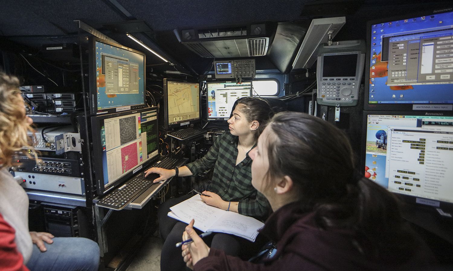 Radar meteorologist from the Center for Severe Weather Research, Alycia Gilliland (left) demonstrates how to use the Doppler-on-Wheels (DOW) mobile weather radar to Haley Okun '18 and Elizabeth McCabe '18. As part of a grant awarded by the National Science Foundation, the DOW will be in the region through April 17 for an extensive education and outreach program.
