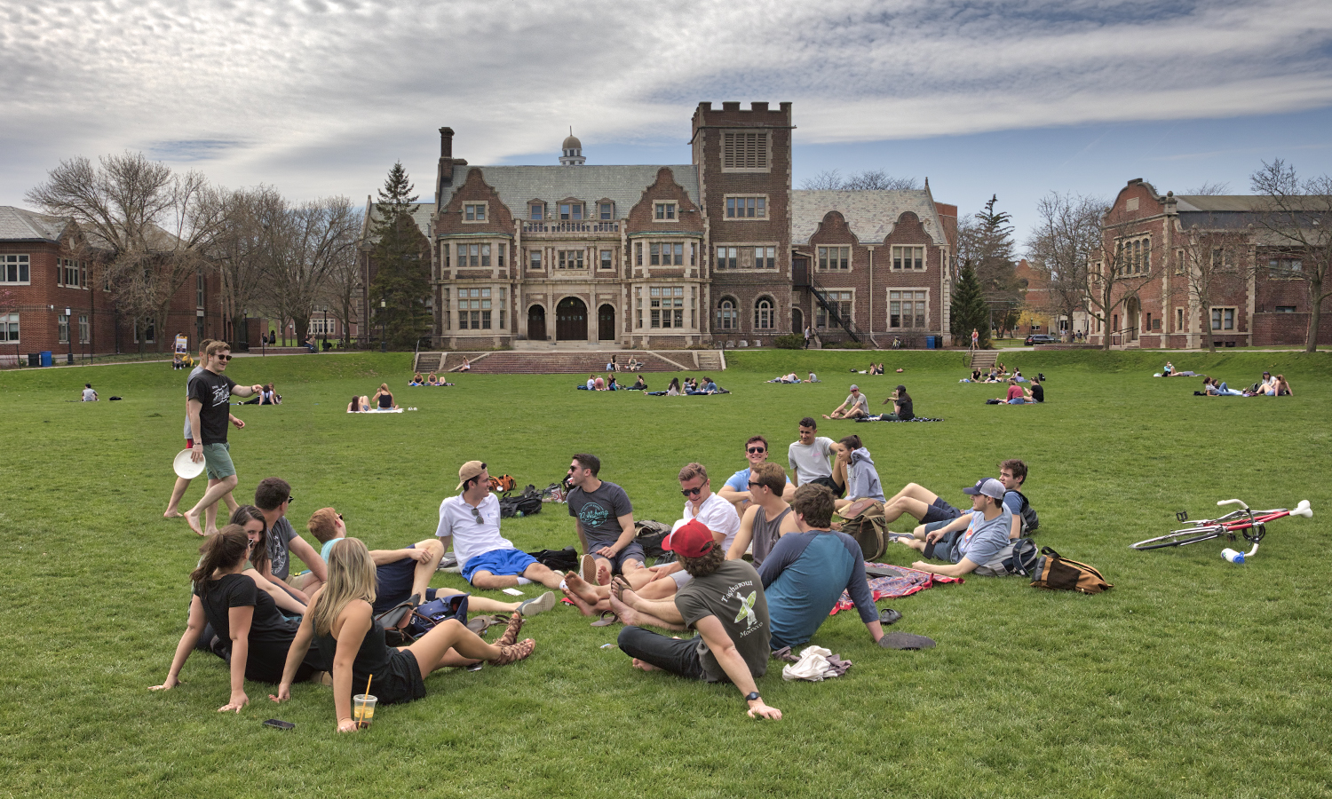 Students enjoy warm weather on the Quad.