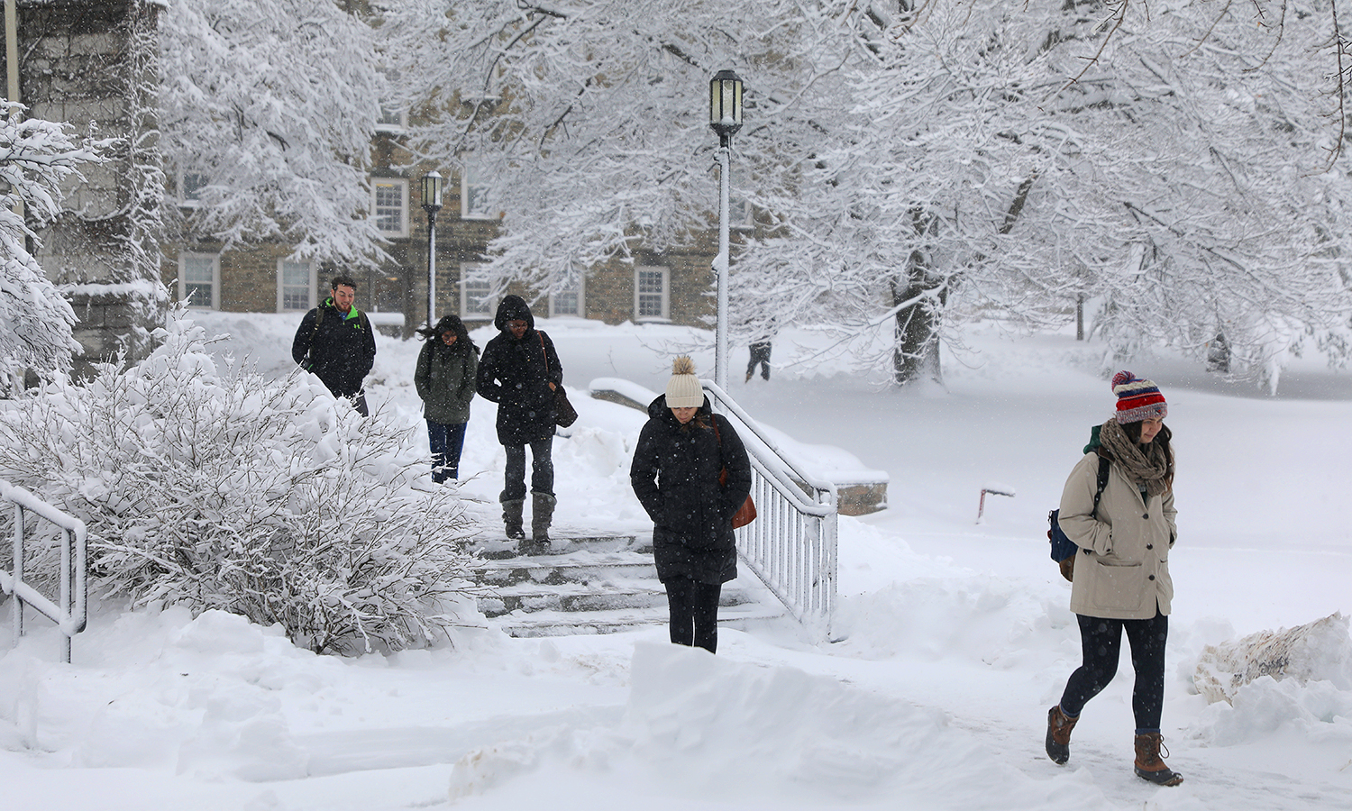 Students walk to class on Friday following an early morning snowfall.