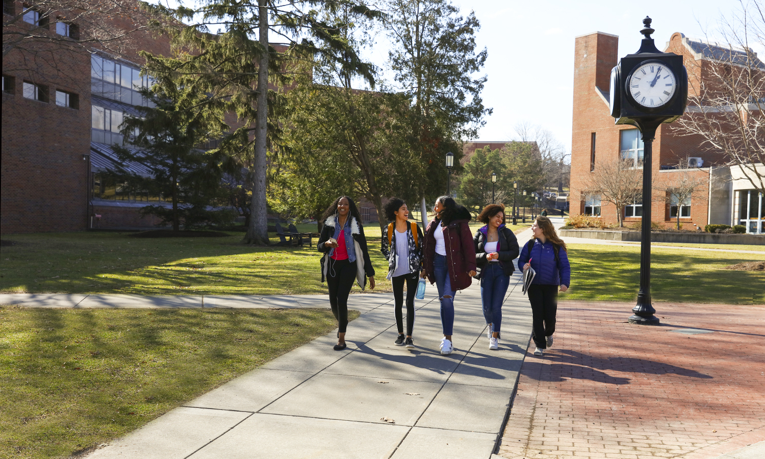 Tebyan Ali '21, ​Alexis Martinez '21, ​Yalemwork Teferra '21, Sarah Starks '21 and Chloe Brown '21 walk through campus.
