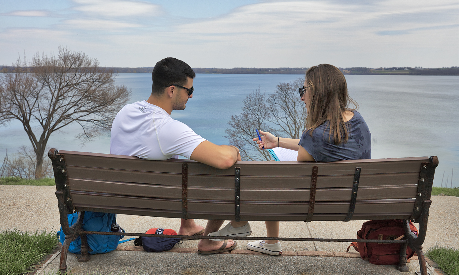 Students enjoy the view of Seneca Lake while studying on South Main Street.