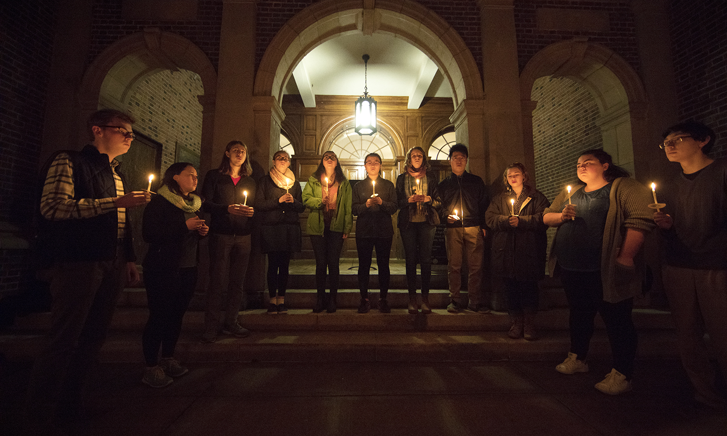Members of HWS a cappella group Perfect Third sing during the candlelight vigil on Tuesday.
