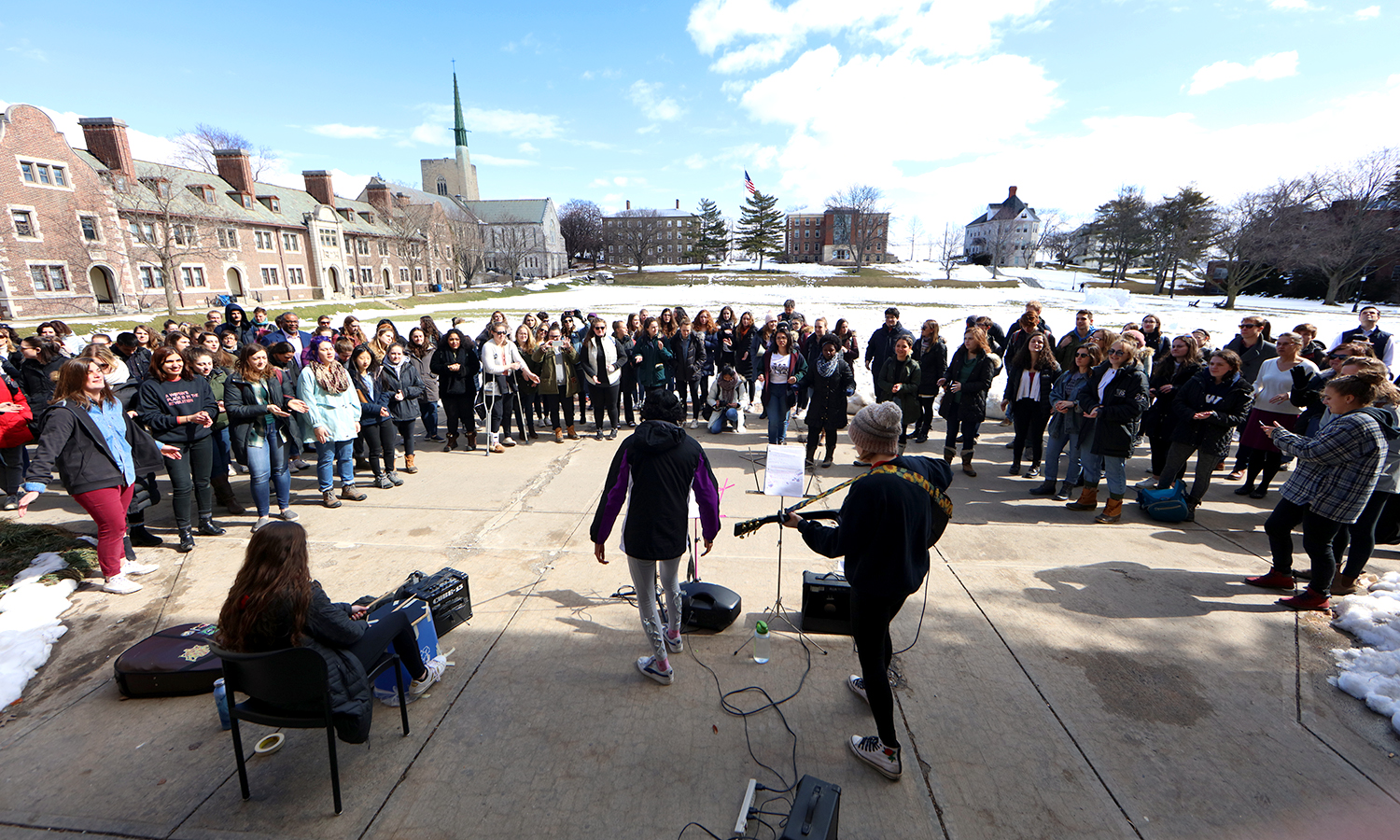 Students perform on the steps of Coxe Hall as part of International Women's Day events on Thursday.