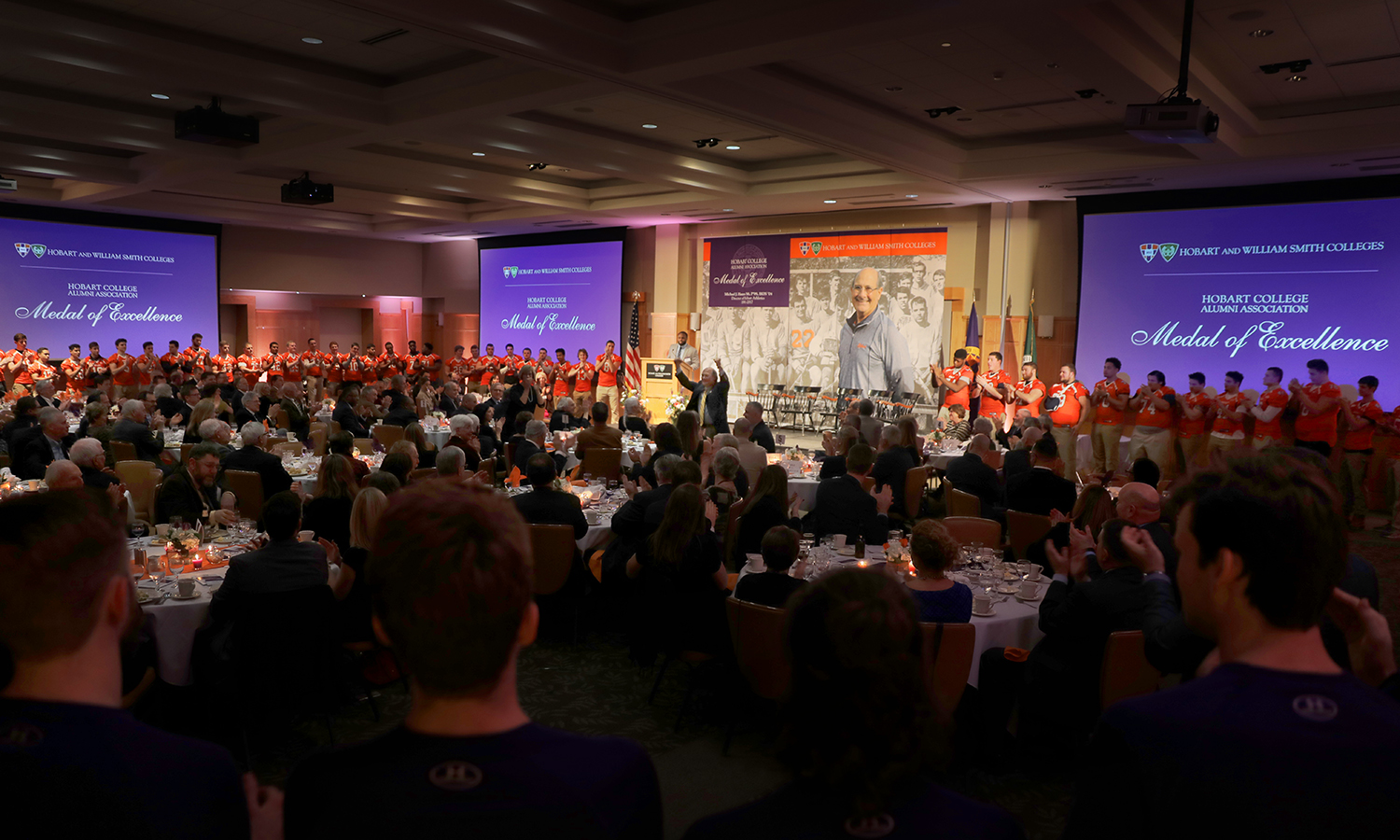 During a toast presented by Al Smith '19, members of Hobart Athletics processed in to the Vandervort Room, on behalf of Statesmen across the country, to celebrate the leadership of Michael J. Hanna '68, P'99, HON'04, who received the Hobart Medal of Excellence.