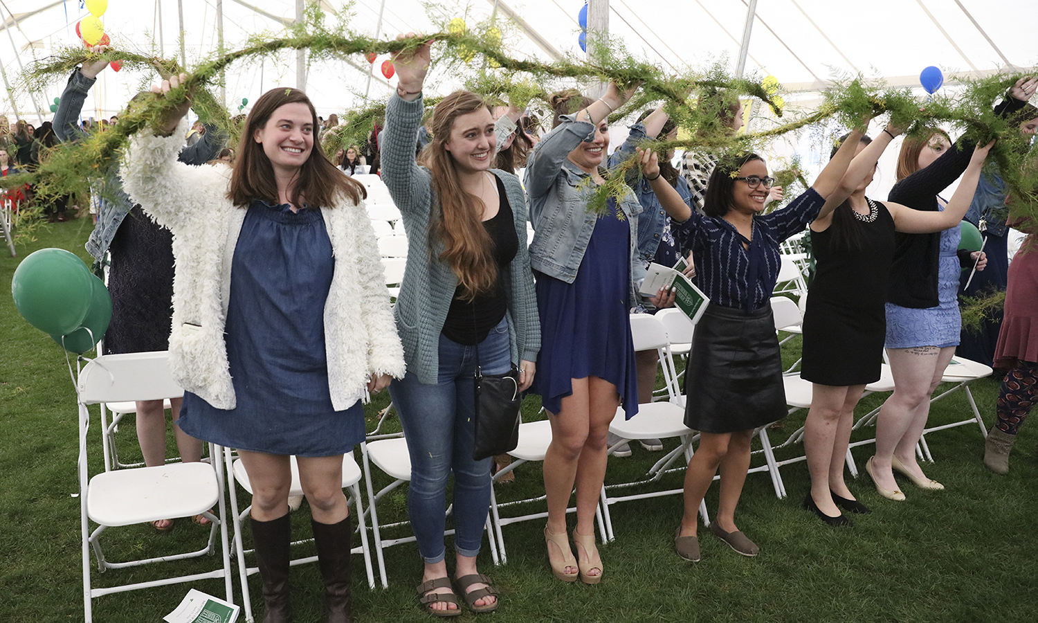 "Members of the William Smith Class of 2018 pass the laurel to members of the Class of 2019. The passing of the laurel recognizes each class as they ""move up"" to fill the vacancy left by the class ahead of them."