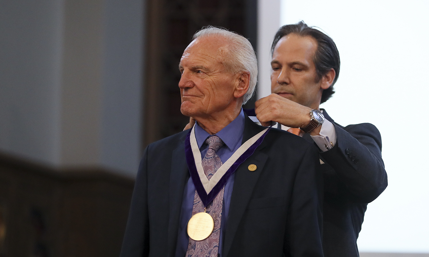 During Charter Day, Assistant Vice President for Advancement and Alumni Relations Jared Weeden '91 presents the Hobart Medal of Excellence to Hobart Dean and Professor of Philosophy Eugen Baer P'95, P'97.