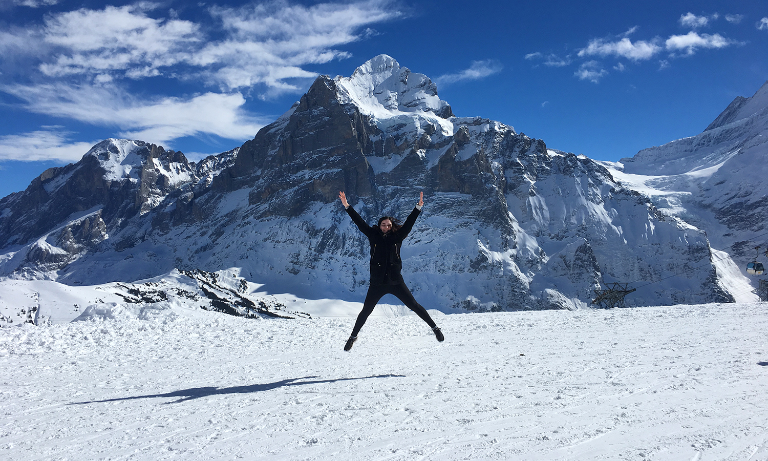 Sarah Burstein '19 leaps in the air while hiking along the Alps Mountain Range in Switzerland. Burstein is studying abroad in Copenhagen, Denmark through a partnership with DIS and the Center for Global Education.