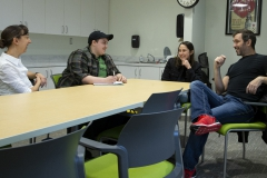 Associate Professors of Theatre Chris Woodworth (left) and Chris Hatch (right) discuss senior capstone performances with theatre majors Kels Veeder '21 and Gianna DeVita '21. Both students will produce, direct and act in a production for their capstone.