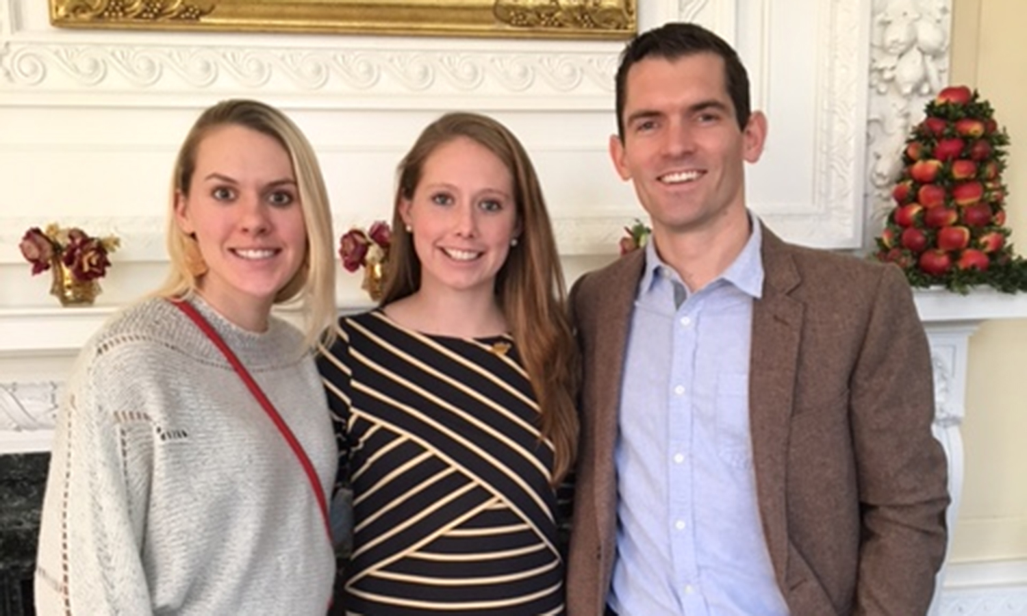Olivia Zitoli, '14, and Tim Sharkey, '10, with Madeline Buckley, '15, at her graduation ceremony at Wheelock College in Boston on Sunday. Buckley earned her Master of Science in Child Life Studies.