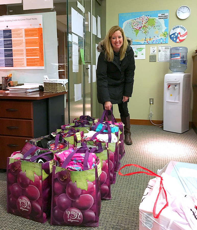 Leadership Giving Manager Dulcie Meyer rounds up gifts for children from Geneva Head Start and Geneva ABCD. This holiday season, over 80 children will receive gifts from generous HWS employees and students