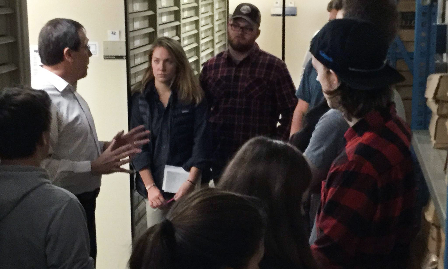 Associate Director of Outreach for the Paleontological Research Institution Rob Ross leads HWS Geoscience students a tour of the museum and the collections department.