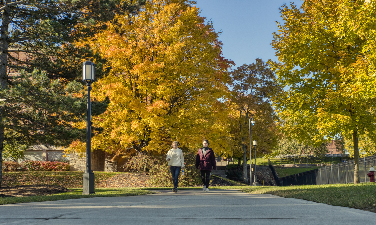 Olivia Wojnovich '20 and Teresa Kepes '21 follow the path along Cozzens field.