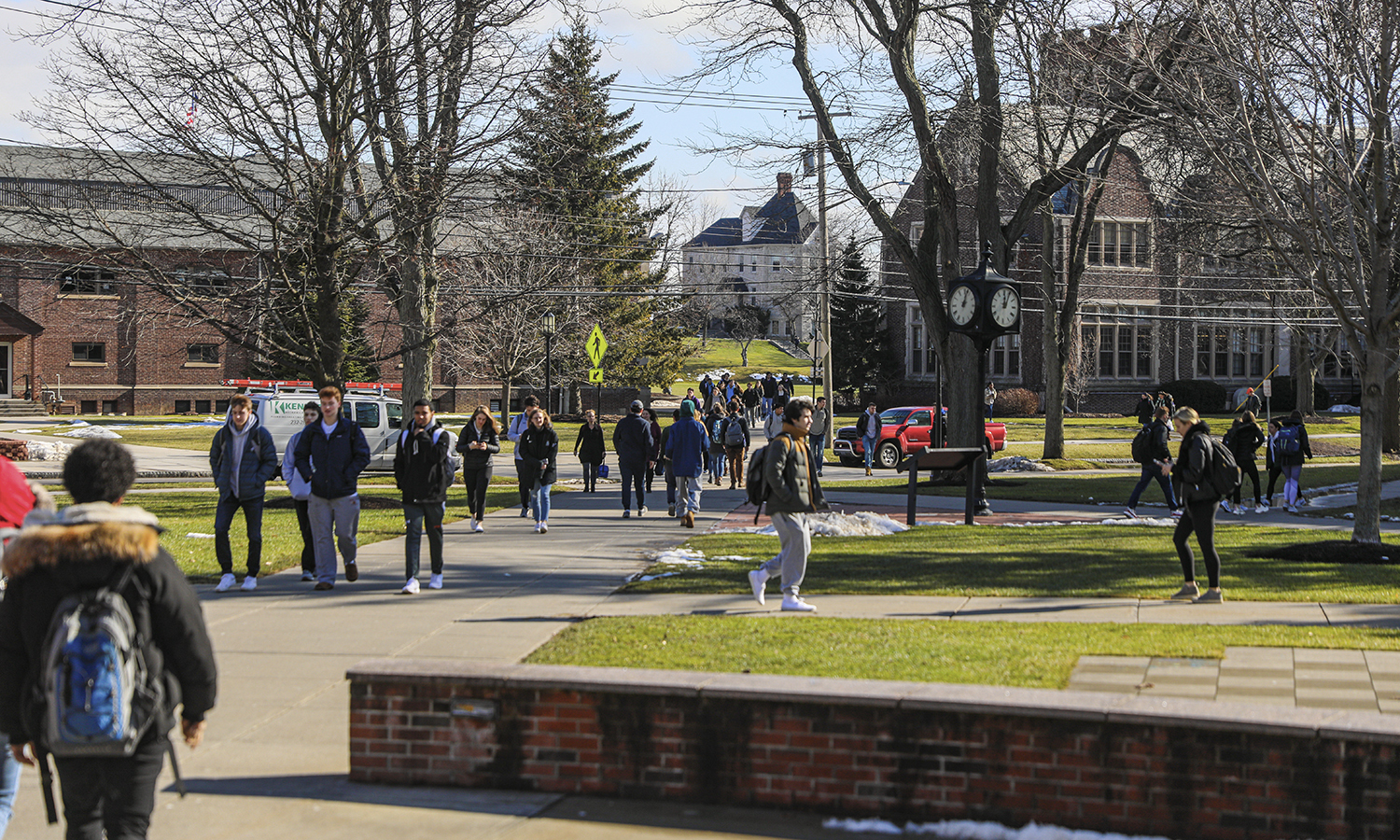Students walk to Scandling Campus Center on Monday.