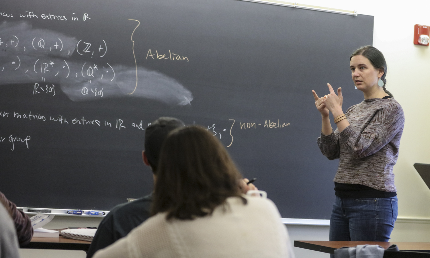 """Assistant Professor of Mathematics and Computer Science Jennifer Biermann presents the definition of a group during """"Abstract Algebra."""""""