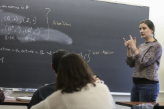 "Assistant Professor of Mathematics and Computer Science Jennifer Biermann presents the definition of a group during ""Abstract Algebra."""