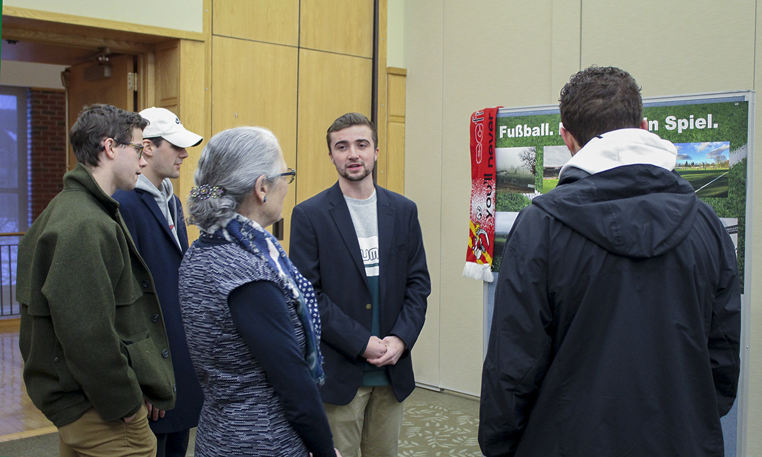 Luke Millspaugh '20 (center) speaks about his project for the Blocker Fellowship in Germany last semester.