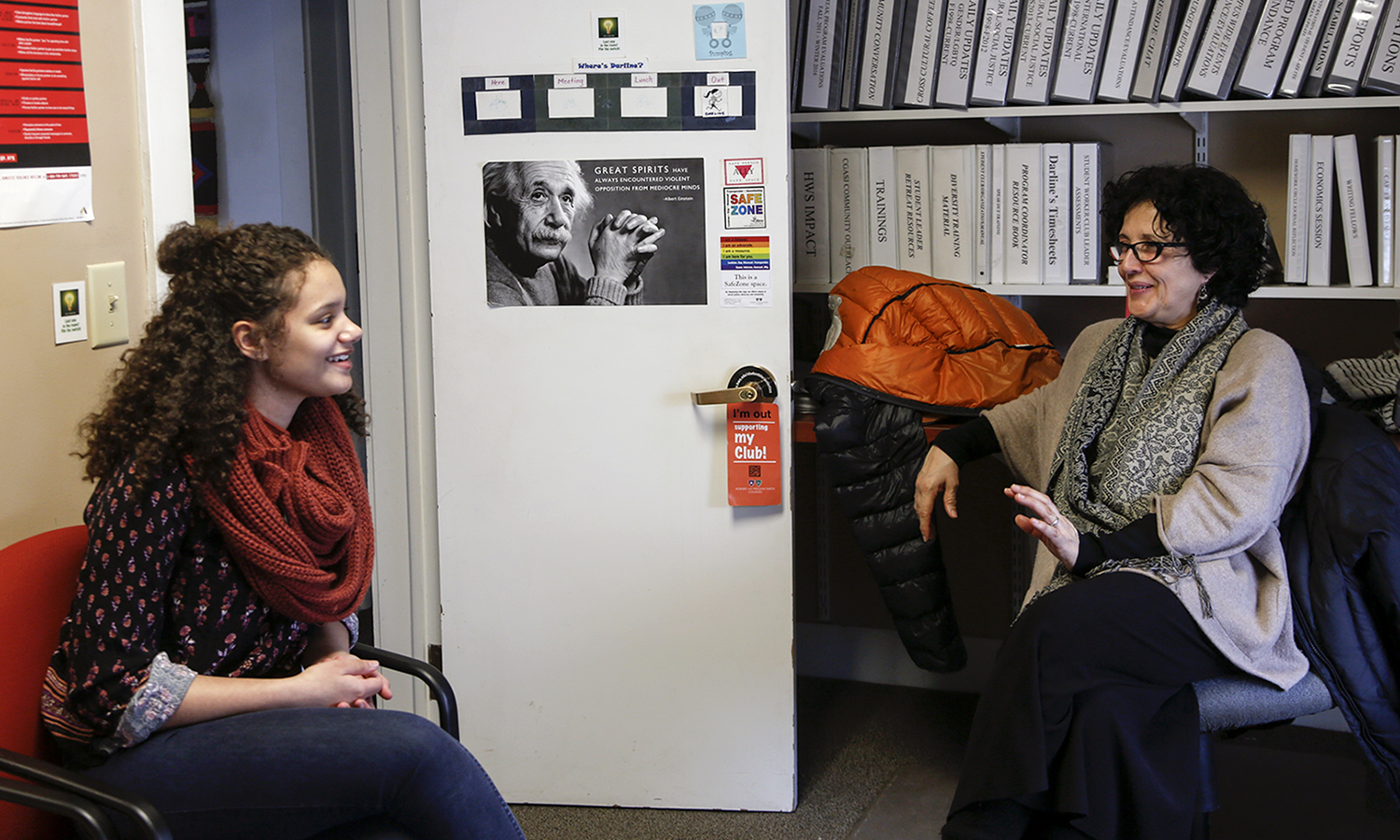 X chats with Director of Intercultural Affairs Alejandra Molina in the Office of Intercultural Affairs.