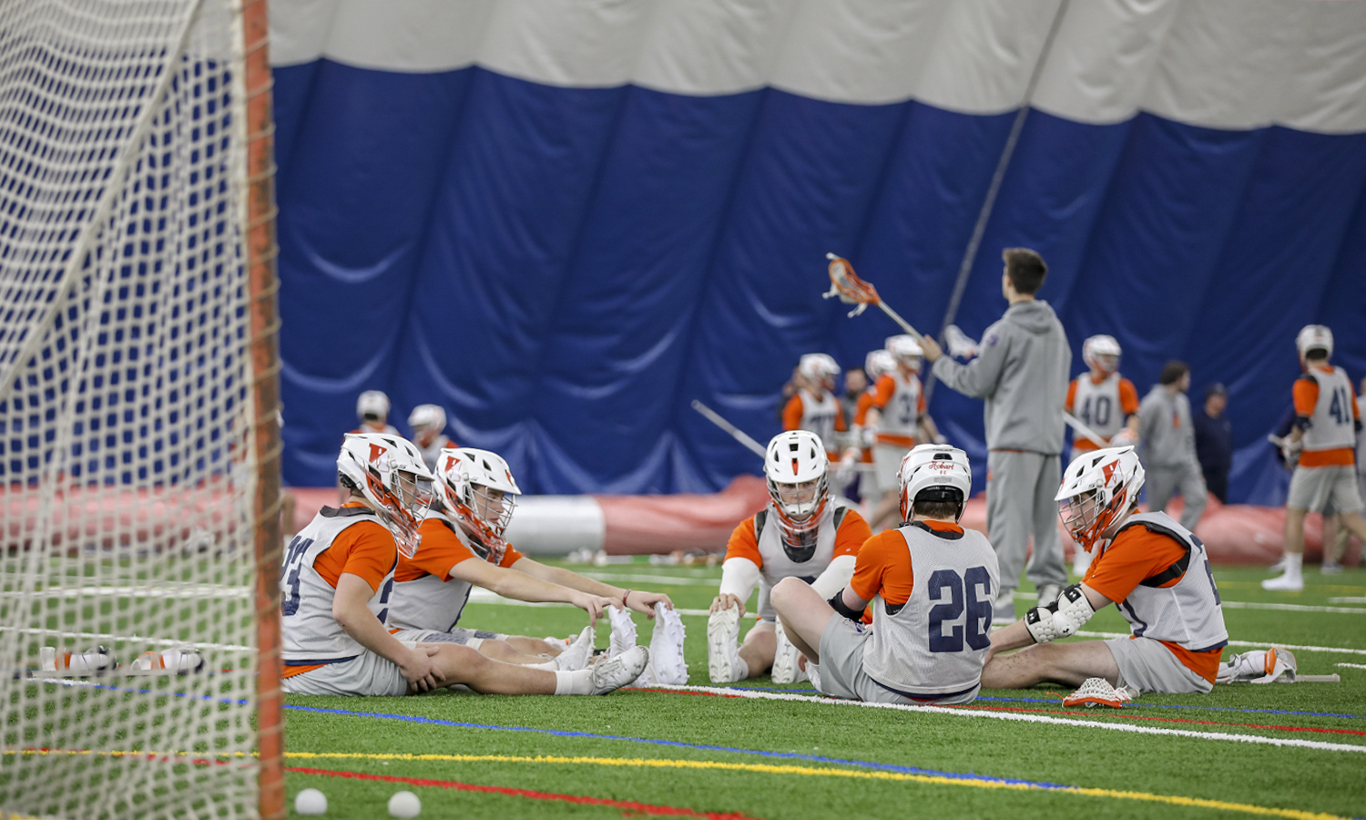 Members of the Hobart Lacrosse team warm up on the new indoor turf field.