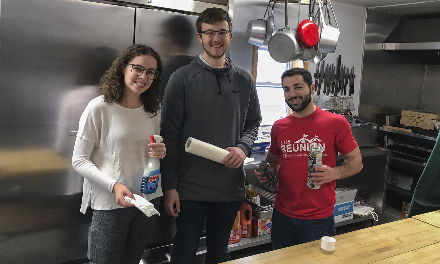 Carling Landeche '21, Grant Emerson '20 and Mike Baroody '21​ finish cleaning the kitchen at the Knights of Columbus as part of the Geneva Heroes program. The program consists of a combination of HWS students and local Geneva Middle and High School students and meets every Saturday to preform service for the Geneva community.
