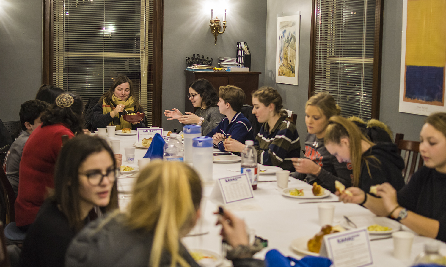 Students enjoy Shabbat Dinner at the Abbe Center for Jewish Life on Friday evening.