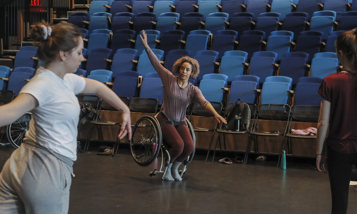 "Guest Artist Alice Sheppard demonstrates a movement during ""Intermediate Modern Dance Technique"" with Assistant Professor of Dance Caitlin Mahon . An award-winning choreographer, Sheppard focuses on creating movement that challenges conventional understandings of disabled and dancing bodies."